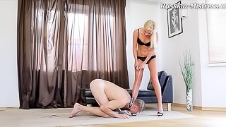 Cute foot fetish dame spanking her slave passionately in BDSM shoot