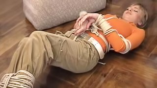 Clothed Russian woman in boots squirming while being tied up