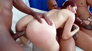 Atlanta is a horny redhead with big butt and small boobs. She takes two big chocolate cocks at once in interracial threesome action. She gets banged from behind and gives mouth job at the same time