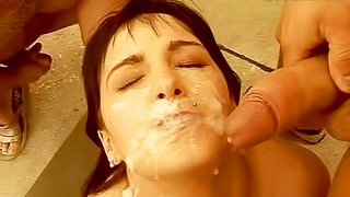 Short haired amateur bitch with natural tits gets her pretty face covered with massive loads of cum in close up after rough gang bang with filthy dudes in front of mansion
