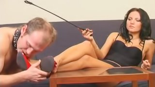 Cute foot fetish dame giving slave nice handjob in BDSM porn